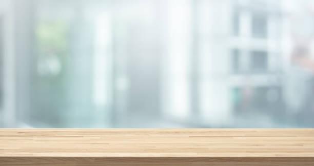 selective focus of wood table top on white wall glass (big window) background - focagem no primeiro plano imagens e fotografias de stock