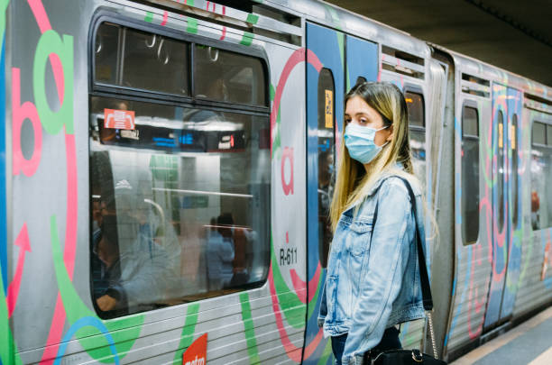 Selective focus of young woman wearing face covering at a metro station in Lisbon, Portugal stock photo