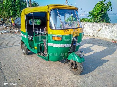 Kolkata, West Bengal / India - December 4, 2019: Selective focus on an auto rickshaw waiting for passengers on streets of Kolkata, India