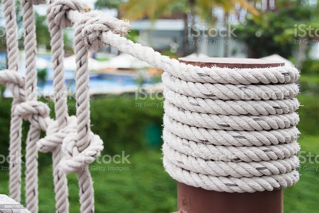 Selective Focus On Big Rope Wrapped Around The Strong Post Stock