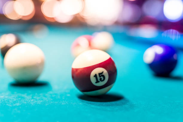 Selective focus on billiard ball number fifteen stock photo