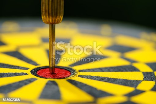 istock Selective focus on gold needle dart in the center of dartboard as Business goal or target concept 813902368