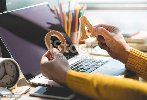 istock Selective focus / Q and A concepts with person holding mock up letter on desk table 1206772838