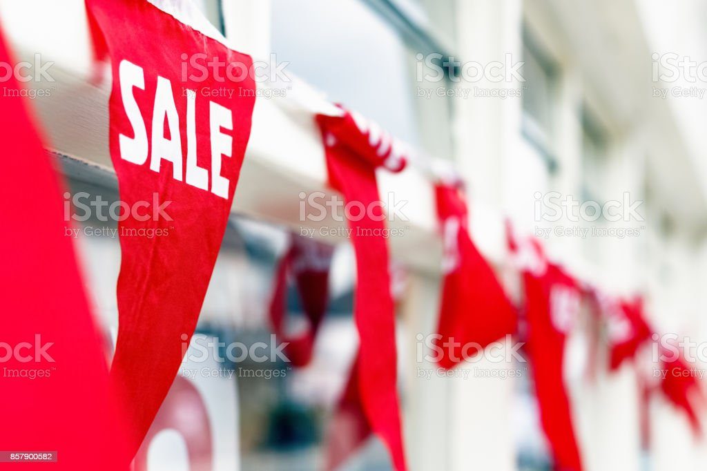 Selective focus, sale bunting outside a shop stock photo