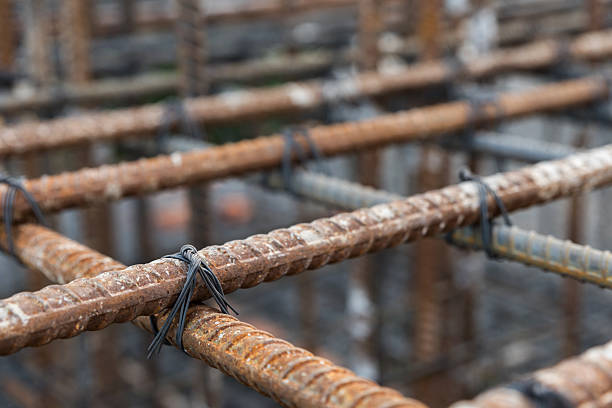 selective focus steel tied at construction site - construction material stock photos and pictures