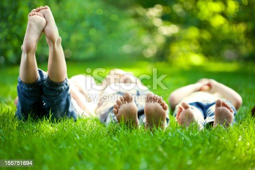 istock Selective focus three children in grass at picnic 155751694