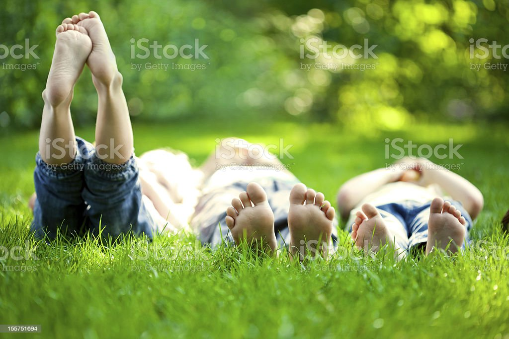 Selective focus three children in grass at picnic stock photo