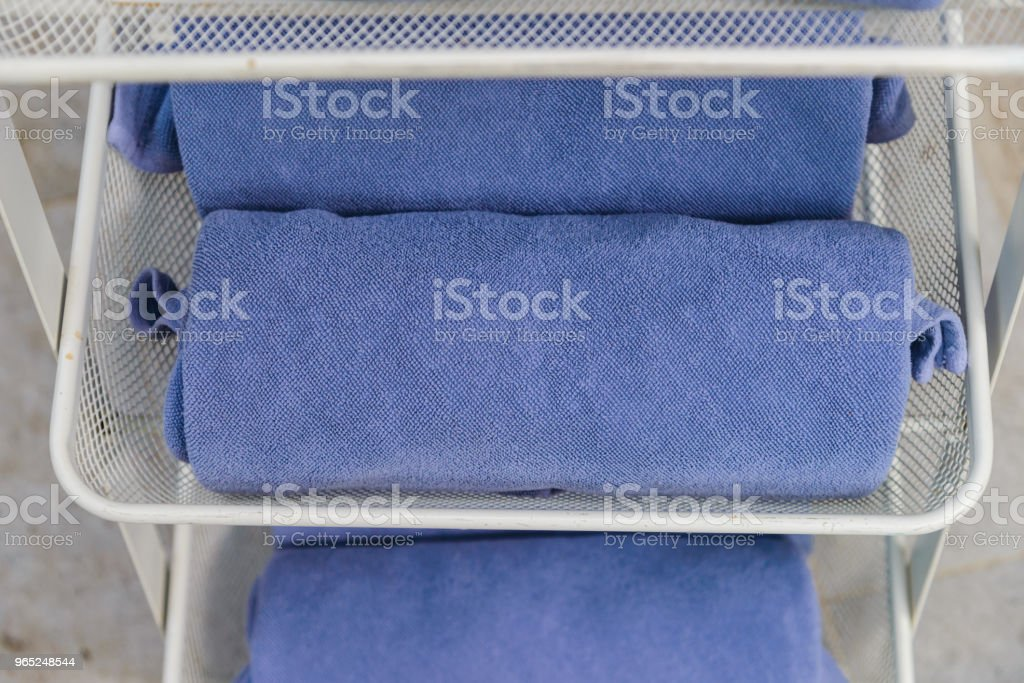 Selective focus to rolled blue towels - Relax time zbiór zdjęć royalty-free