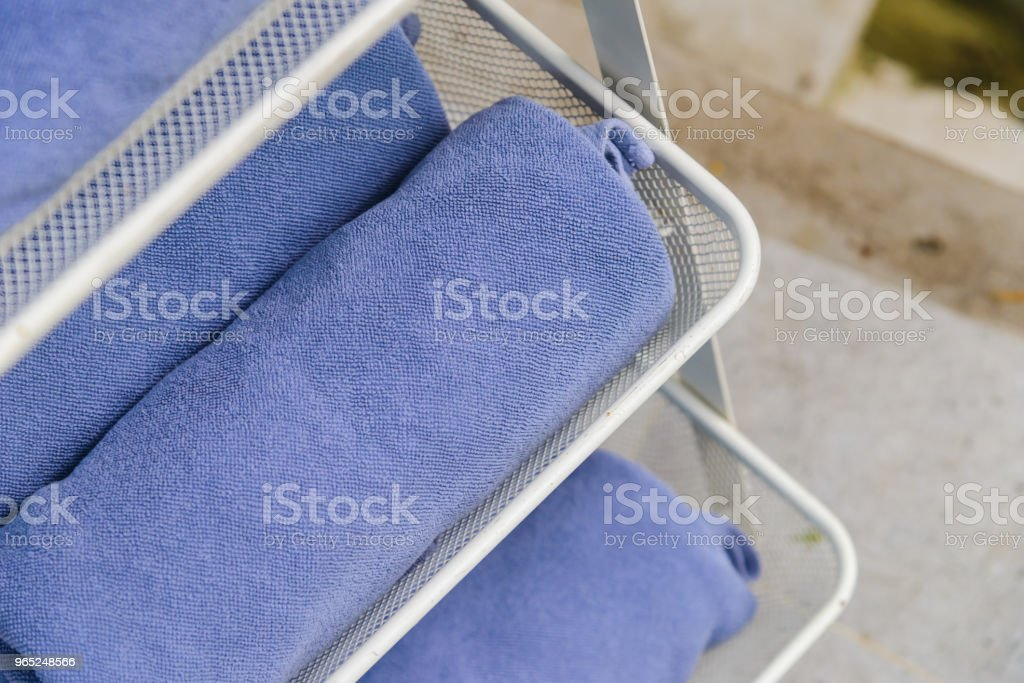 Selective focus to rolled blue towels - Relax time royalty-free stock photo
