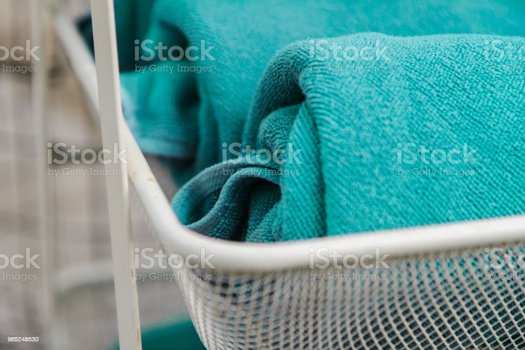 Selective focus to rolled green towels - Relax time zbiór zdjęć royalty-free