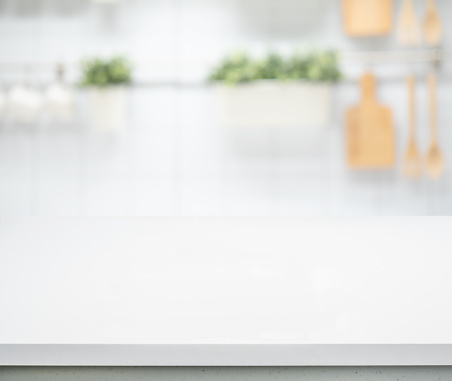 Selective focus/White wood table top on blur kitchen counter