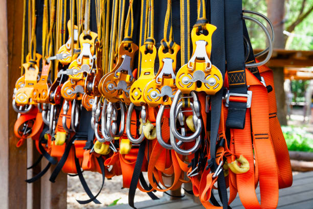 Self belay safety equipment at a ropes course in a treetop adventure park Close-up shot of safety harness self belay equipment at ropes course in outdoor treetop adventure park safety harness stock pictures, royalty-free photos & images