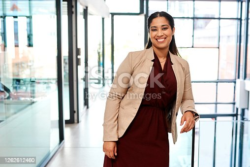 Portrait of a young businesswoman standing in an office