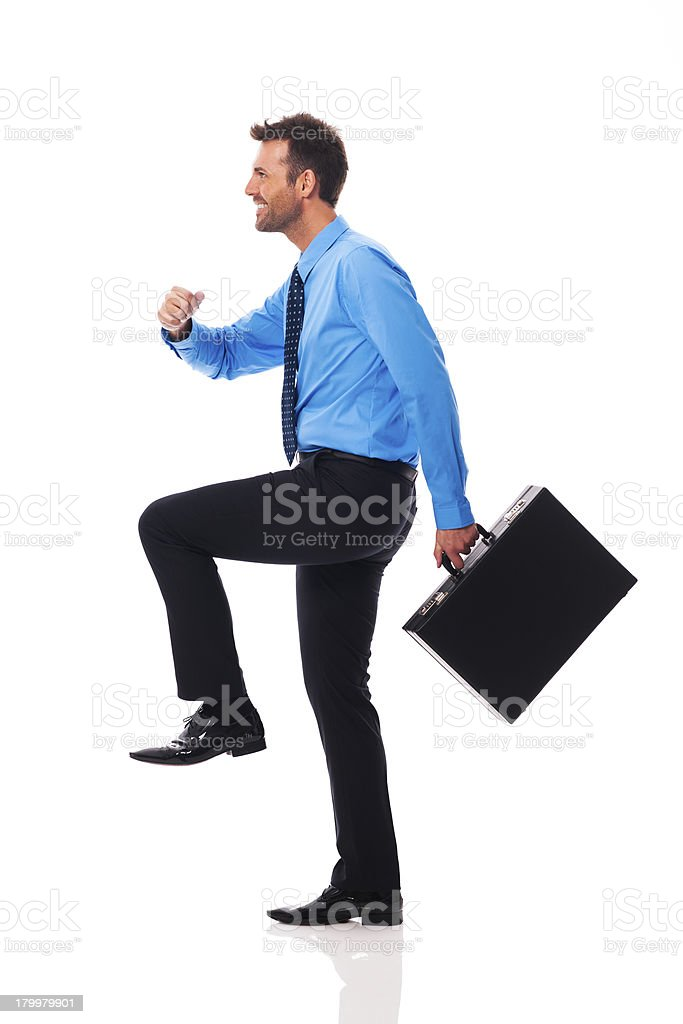 Self confident businessman climbing for success royalty-free stock photo