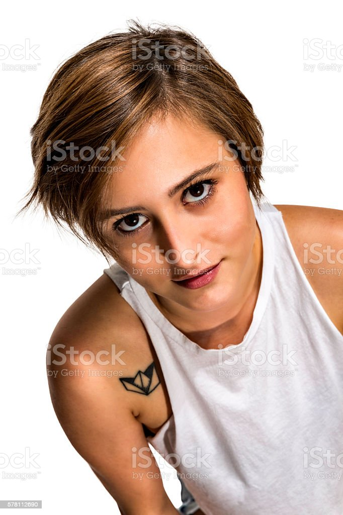 Self confident gender fluidity Hispanic young woman with tatoo stock photo