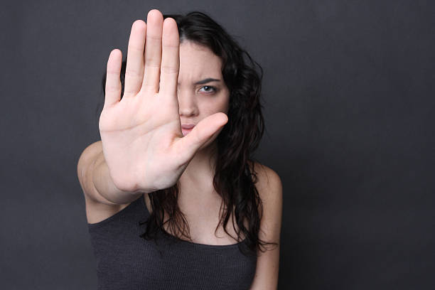 self defense angry girl holds up her hand to stop pretator and end the cycle of abuse stop single word stock pictures, royalty-free photos & images