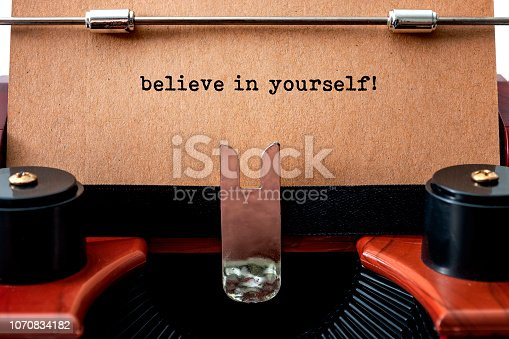 istock Self determination and motivational quote concept with close up on the print text believe in yourself in a vintage typewriter 1070834182