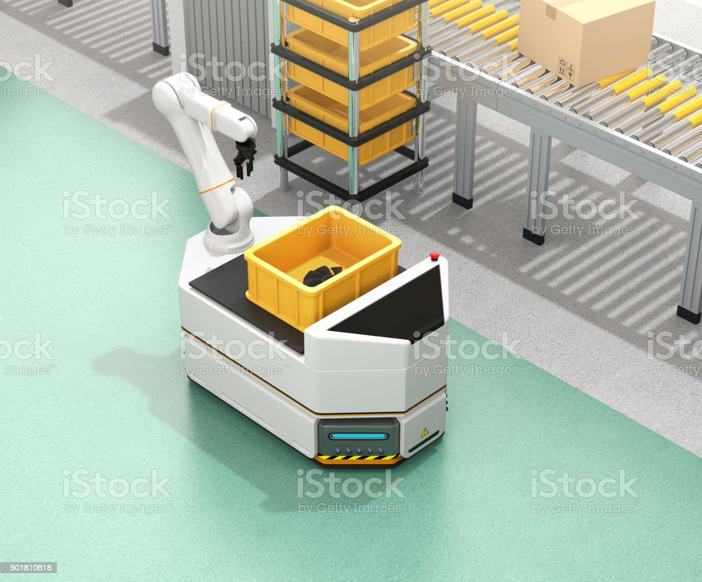 Self driving AGV  with robotic arm moving beside conveyor stock photo