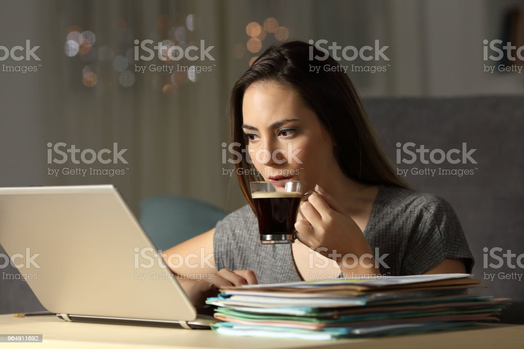 Self employed working late hours in the night royalty-free stock photo
