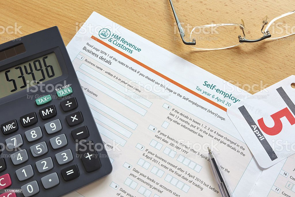 Self employment tax form stock photo