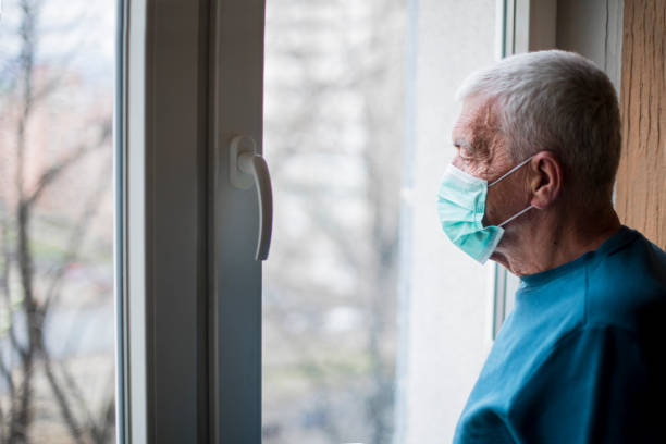 Self isolation an protection for senior citizens stock photo
