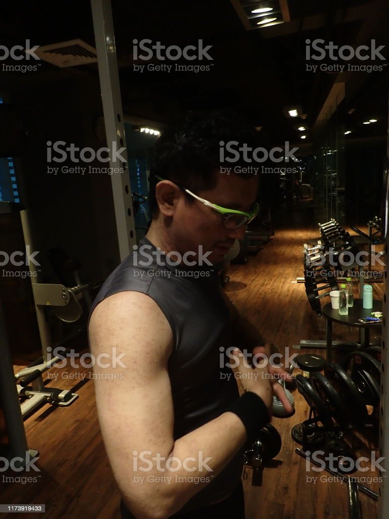 A man is fitness trainer doing exercise and fitness gym