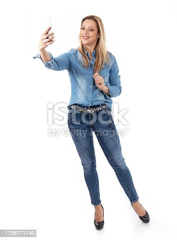 istock Self portrait of an attractive woman 1126771740