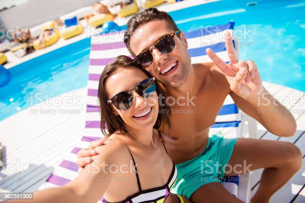 Self portrait of attractive stylish cheerful couple in summer glasses picture id962351300?b=1&k=6&m=962351300&s=612x612&h=j o0vbkvc4ifaezisujihlz4ghi9 hovcb4e cqlonk=