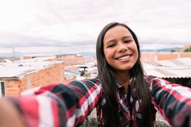Self portrait of beautiful girl in shanty town. stock photo