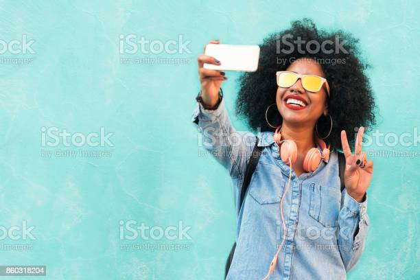 Self portrait of beautiful young afro american woman making peace picture id860318204?b=1&k=6&m=860318204&s=612x612&h=8rcp7o0bgzi1o4l85wlgursbglxnqmmqomwoubjfenm=
