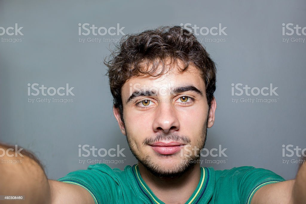 Self portrait of young man taking a selfie stock photo