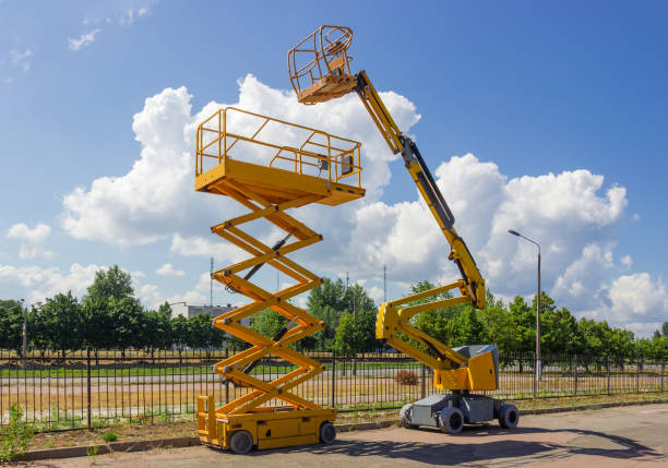 Self propelled wheeled articulated boom lift and scissor lift stock photo