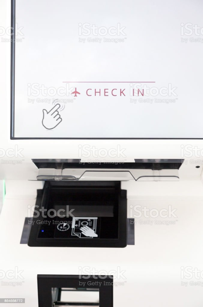 Self service check in machine kiosk on airport stock photo