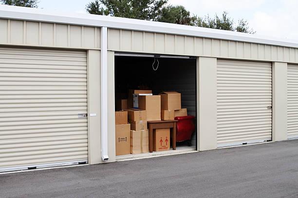 Self storage warehouse with single storage unit open to stock photo