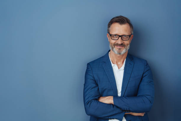 Self-assured attractive middle-aged man stock photo