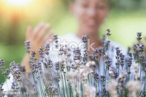 1175869940 istock photo Self-Care Practice in Nature. Breathing Exercise in the Lavender Field. 1187001679