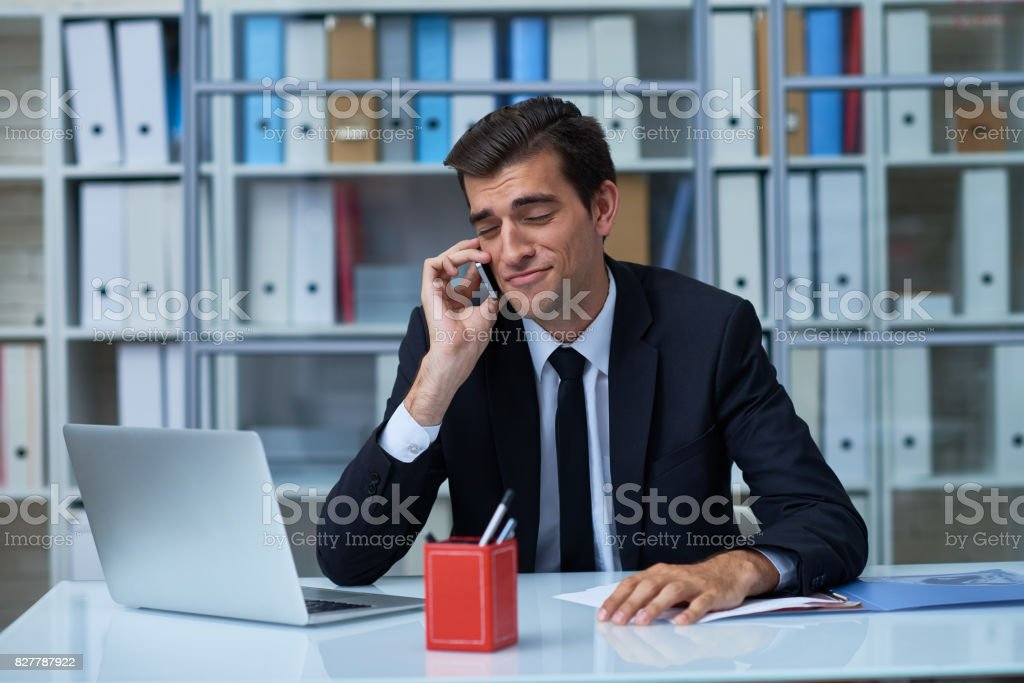 Self-confident manager on phone stock photo