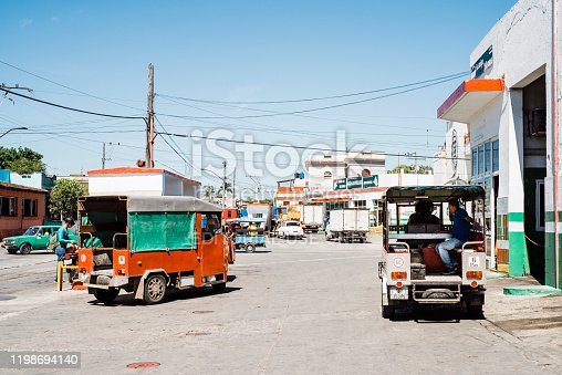 Santa Clara, Cuba - 15 July 2019: Self-constructed minibuses transport people to work, typical morning scene in Santa Clara, Villa Clara Province, Cuba