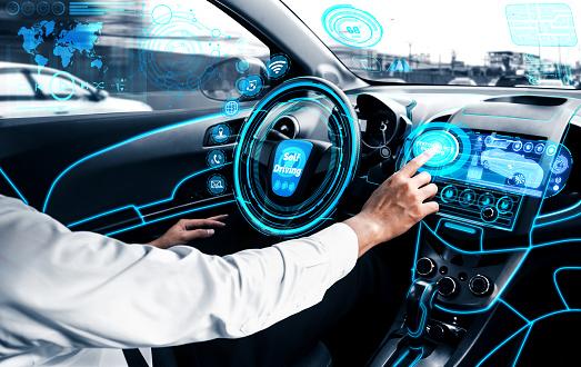 Self-drive autonomous car with man at driver seat.