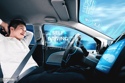 692832436 istock photo Self-drive autonomous car with man at driver seat. 1190949517
