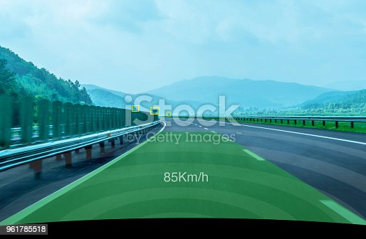 istock Self-driving car driving on the road 961785518