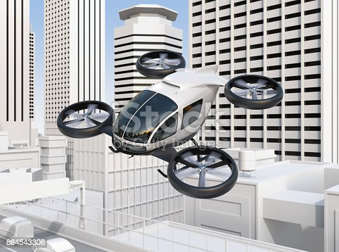 istock Self-driving passenger drone flying over a highway bridge which in heavy traffic jam 864543306