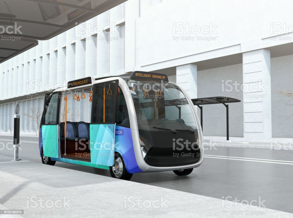 Self-driving shuttle bus waiting at bus station stock photo