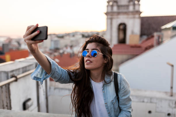 Selfie at Rooftop Bar in Lisbon stock photo