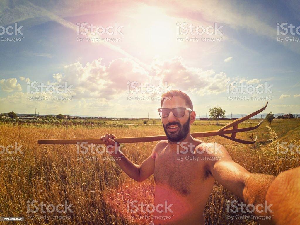 Selfie billhook in the field stock photo