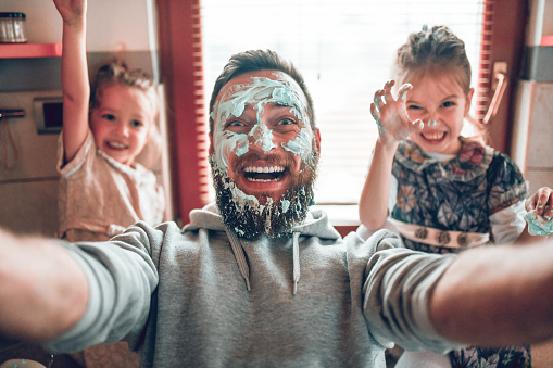Selfie By Father With Cute Child Daughters After Cooking And Making Mess With Topping