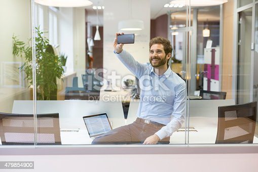 Selfie Casual Businessman Taking Pictures In Open Space Office Stock Photo & More Pictures of 2015