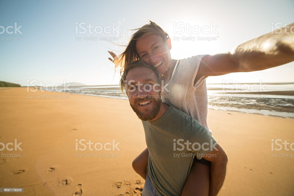 Selfie : Couple capturing fun moments on the beach stock photo