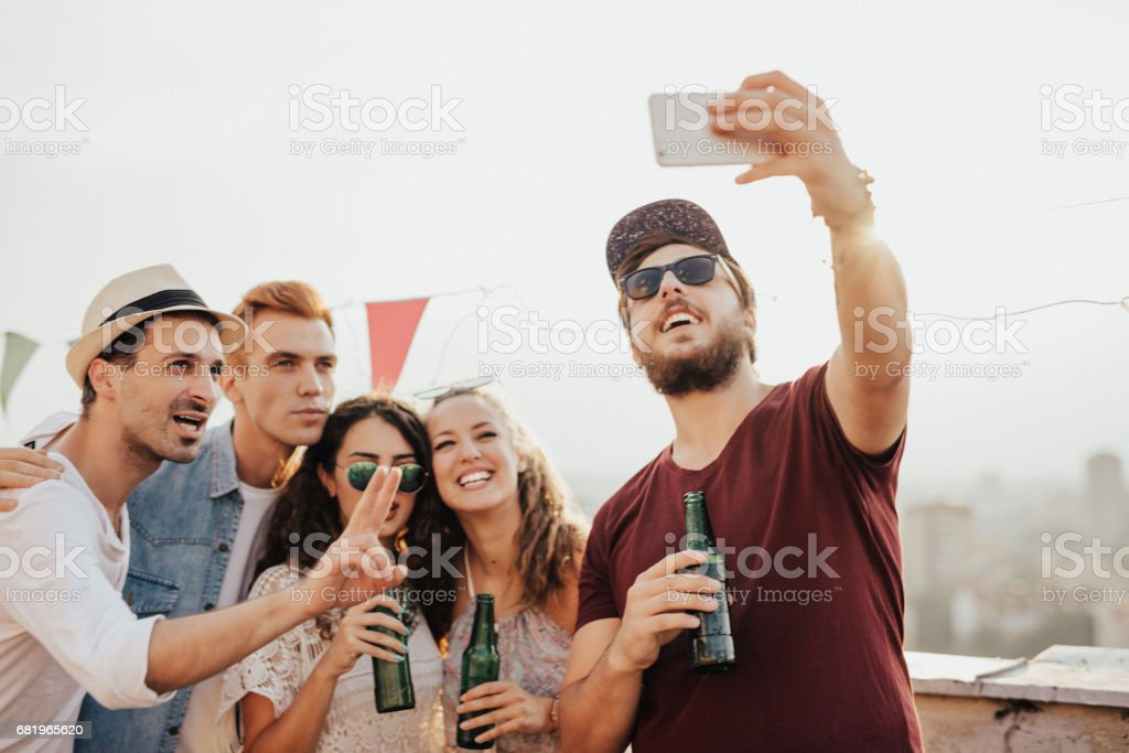 Selfie from a party on the roof stock photo