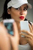 istock selfie - girl making self portrait front of the mirror 517055087